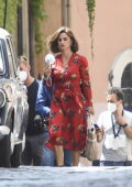Penelope Cruz looks great in a red dress while shooting 'L'immensita' in Latina, Italy