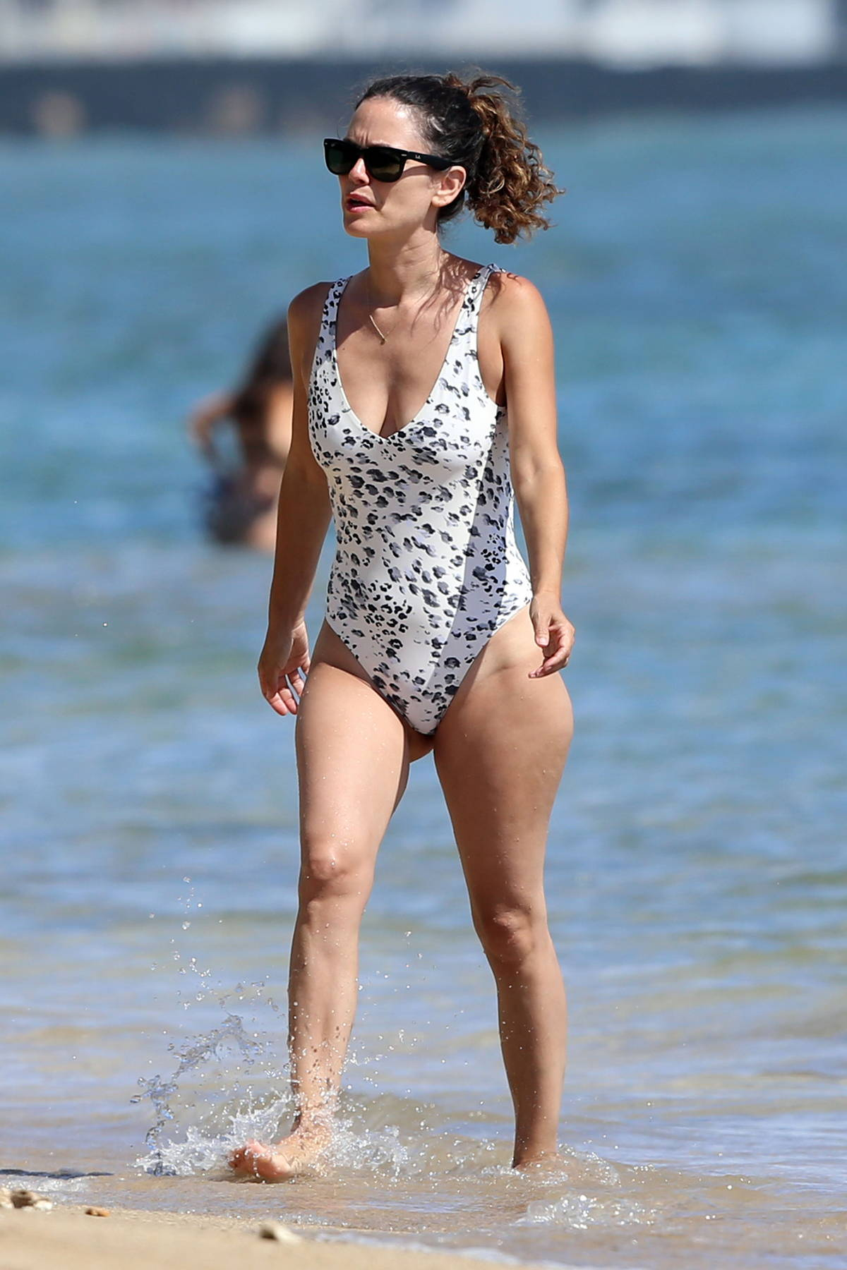 Rachel Bilson looks fab in a patterned swimsuit as she hits the beach while on vacation in Hawaii