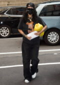 Rihanna keeps it casual in all-black as she arrives at her hotel in New York City