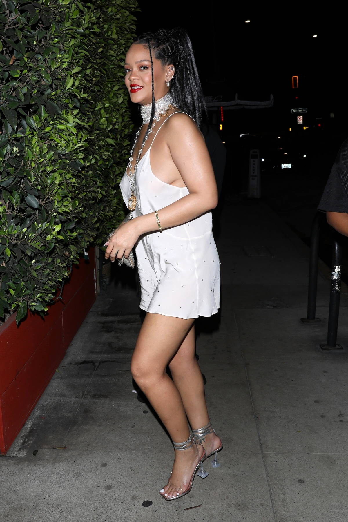 Rihanna looks radiant in a white mini dress while out for dinner with her little friend at Giorgio Baldi in Santa Monica, California