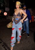 Rihanna looks stylish in Harley-Davidson bandana top and ripped jeans during a night out in New York City