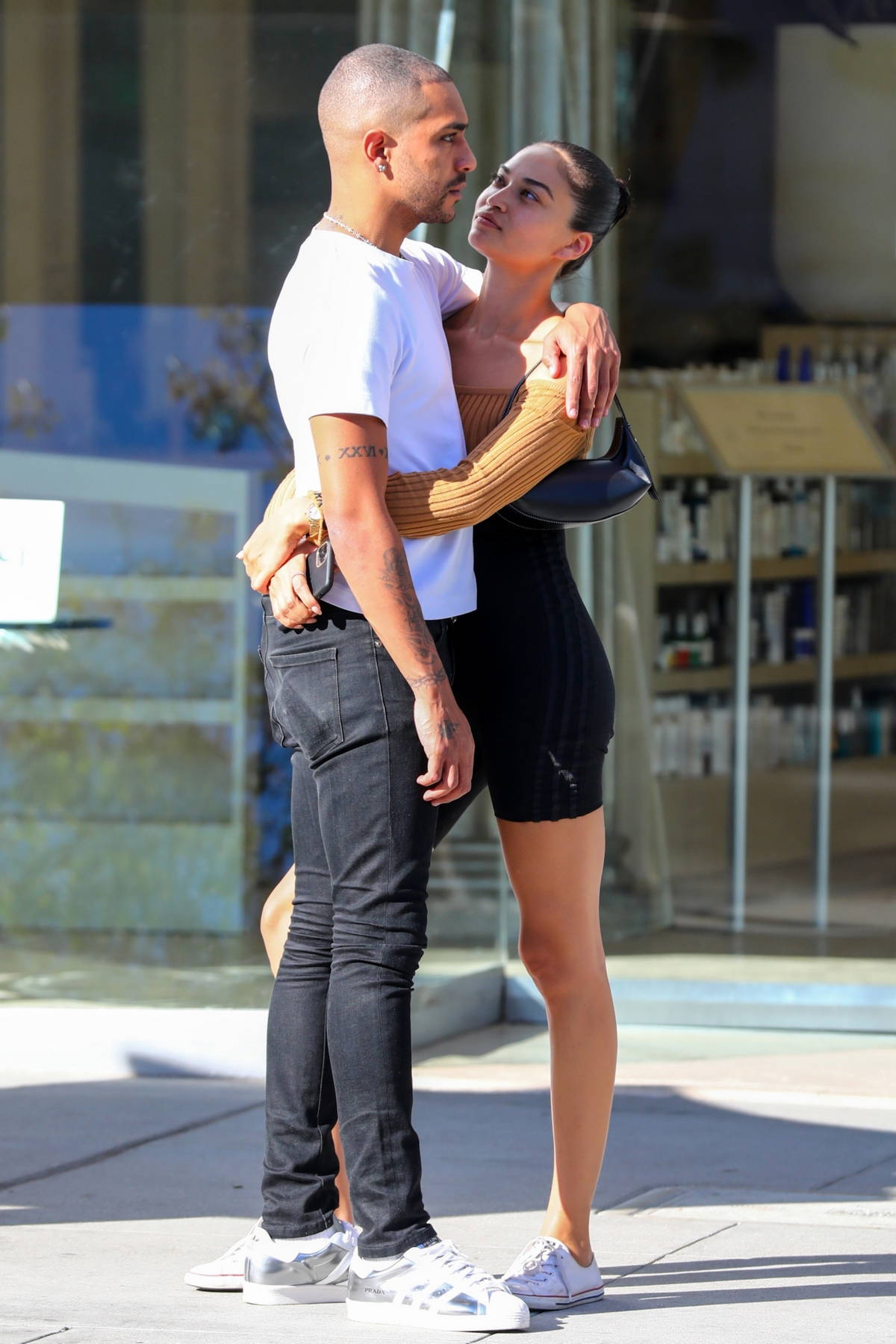 Shanina Shaik shares a loving kiss and embrace with boyfriend Matthew Adesuyan while out to dinner in Beverly Hills, California