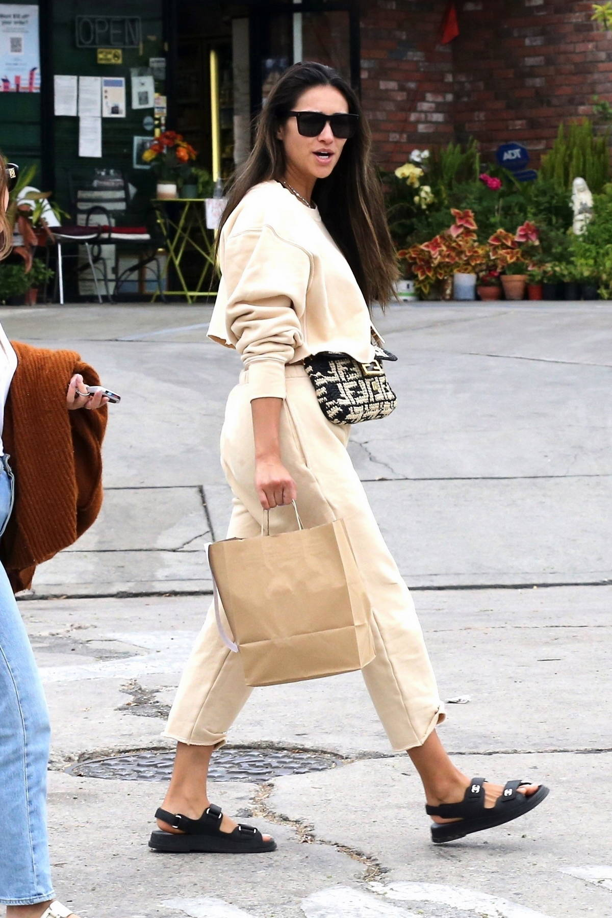Shay Mitchell dons a beige sweatsuit while out grabbing lunch to-go with a friend in Silver Lake, California