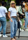 Sienna Miller goes casual in a white tee and blue jeans while stepping out in New York City