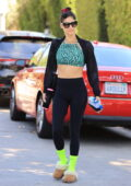 Sofia Boutella rocks a green snakeskin print top, black leggings and neon socks to her Pilates class in West Hollywood, California