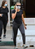 Sofia Richie dons a black top and leggings as she leaves after brunch with a friend at Croft Café in Beverly Hills, California