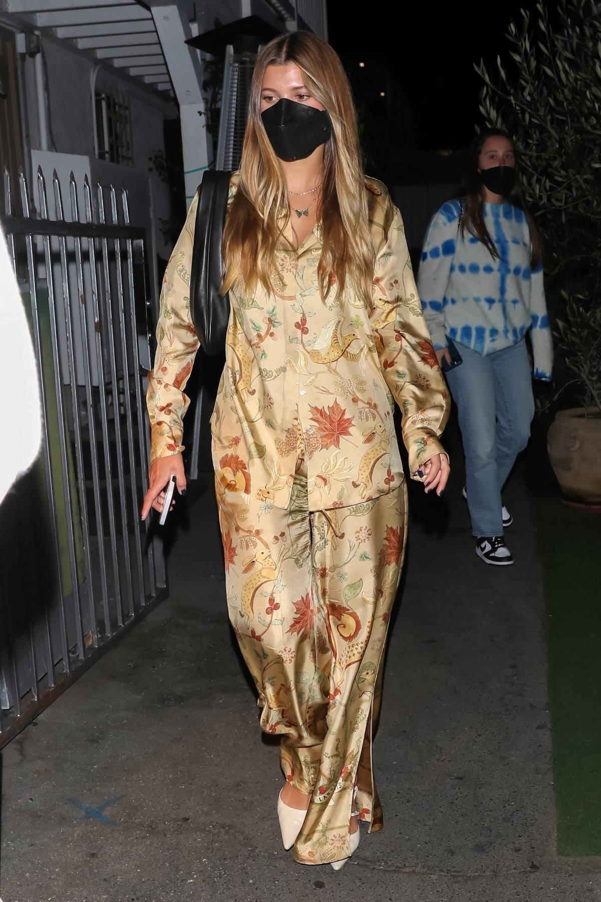 Sofia Richie dons a floral ensemble during a dinner date with boyfriend Elliot Grainge at Giorgio Baldi in Santa Monica, California