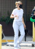 Sofia Richie keeps it simple with a white tee and jeans as she meets a friend for coffee in West Hollywood, California