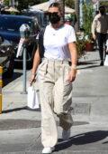Sofia Richie walks ahead of her boyfriend Elliot Grainge while out shopping in Beverly Hills, California