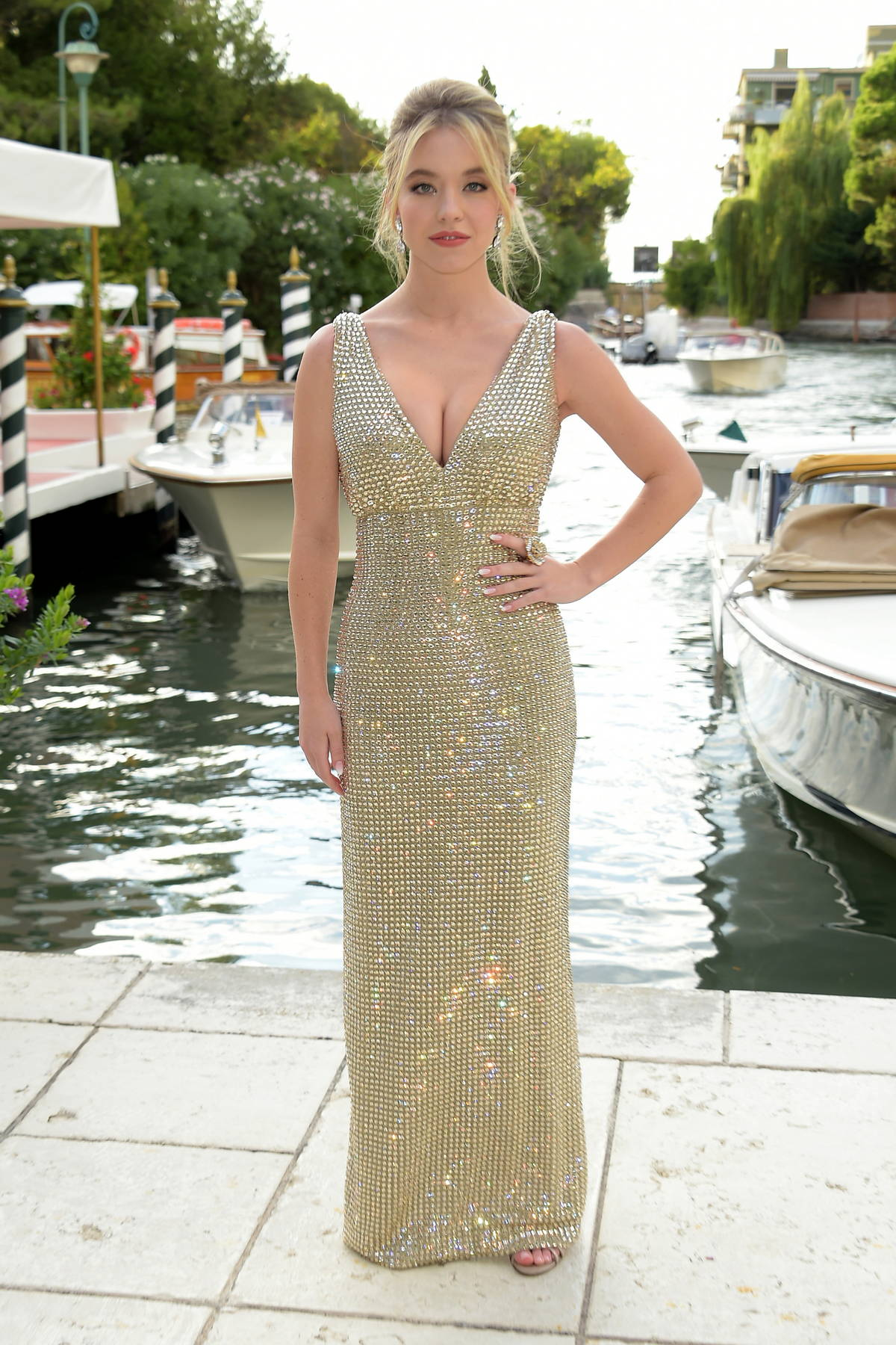 Sydney Sweeney looks stunning in a sparkly dress while attending the Dolce & Gabbana fashion show in Venice, Italy