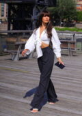 Tao Wickrath looks trendy in a knotted white blouse and black trousers as she steps out in New York City