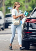 Taylor Hill rocks light blue leggings and tie-dye top while heading to Pilates class in West Hollywood, California