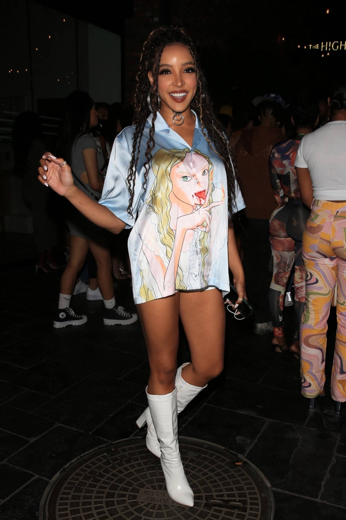 Tinashe flaunts her leg in a short button-down dress and knee-high white boots while arriving at The Highlight Room in Los Angeles