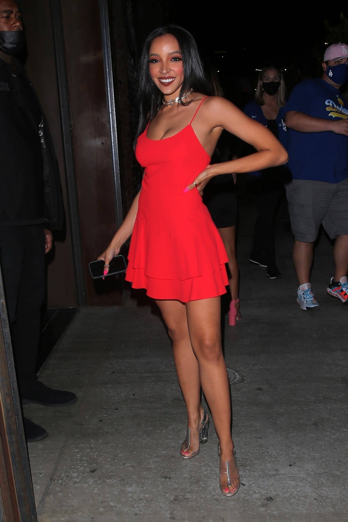 Tinashe looks great in a short red dress as she arrives for dinner at TAO in Los Angeles