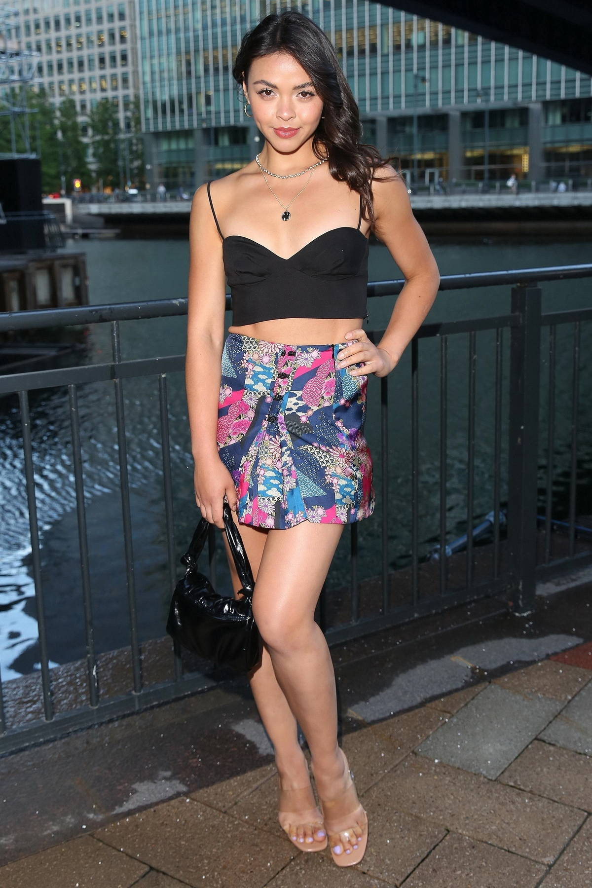 Vanessa Bauer poses in a tiny cropped top and mini skirt at the Six by Nico restaurant launch in Canary Wharf in London, UK