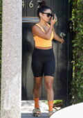 Vanessa Hudgens rocks an orange crop top and black legging shorts as she leaves after Pilates in West Hollywood, California