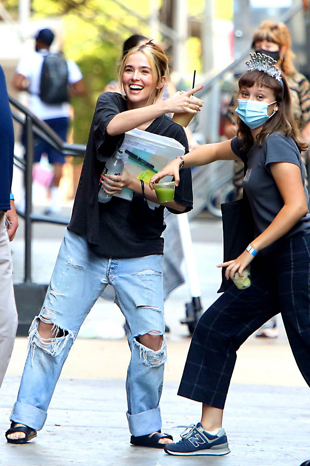 Zoey Deutch is all smiles while on the set of 'Not Okay' in New York City
