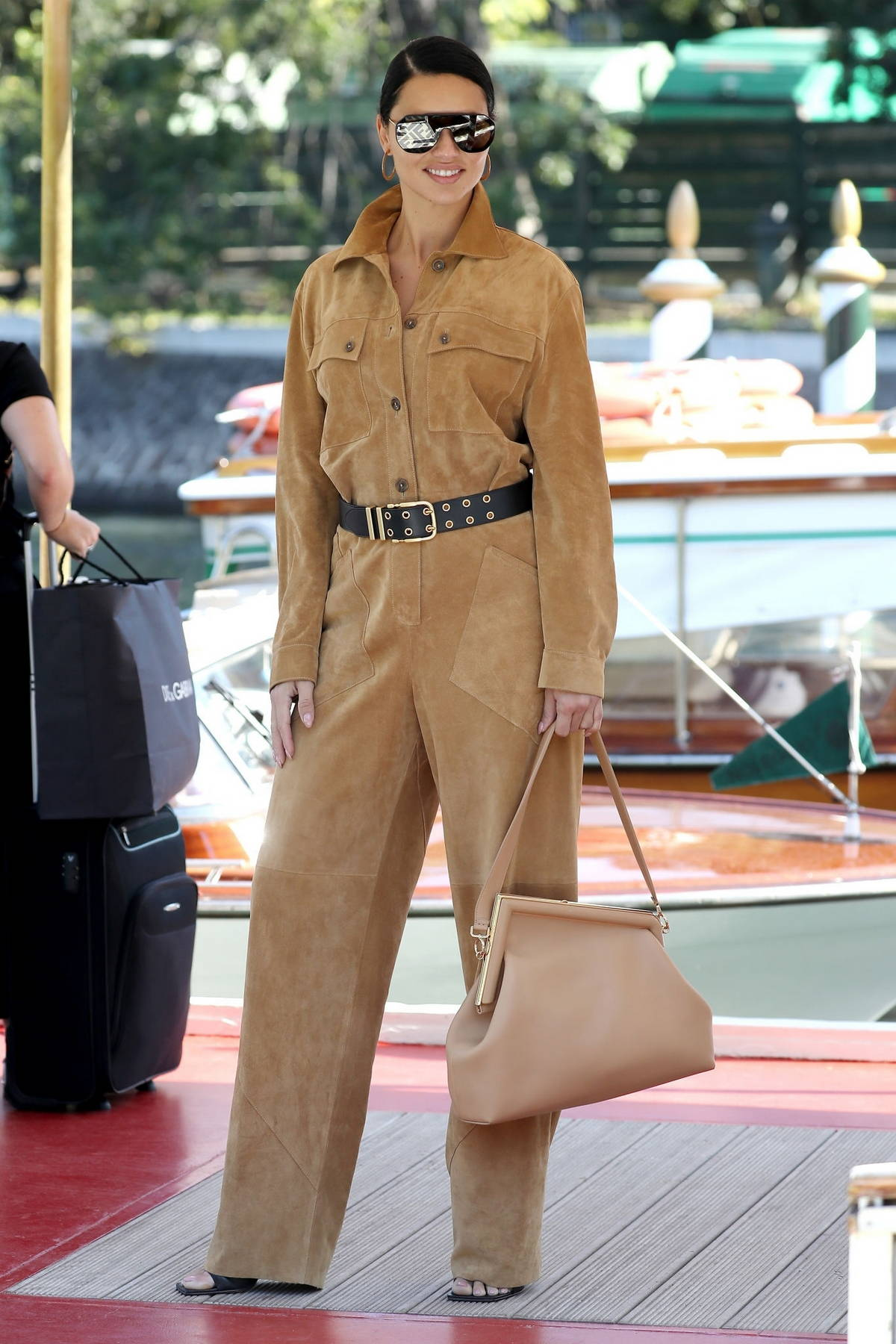 Adriana Lima looks stylish in a brown jumpsuit while arriving at the 78th Venice International Film Festival in Venice, Italy