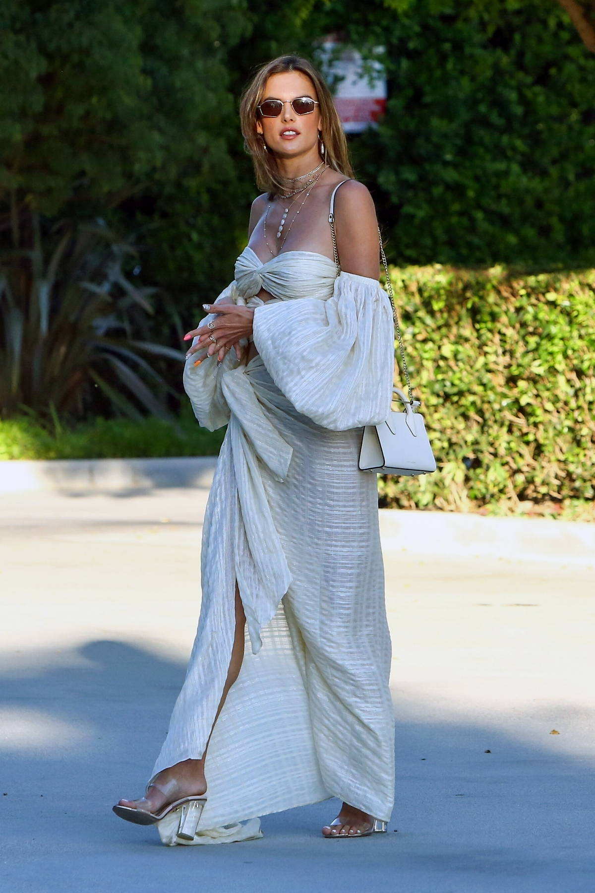 Alessandra Ambrosio looks elegant in an off-the-shoulder white dress while heading out for a party in Malibu, California