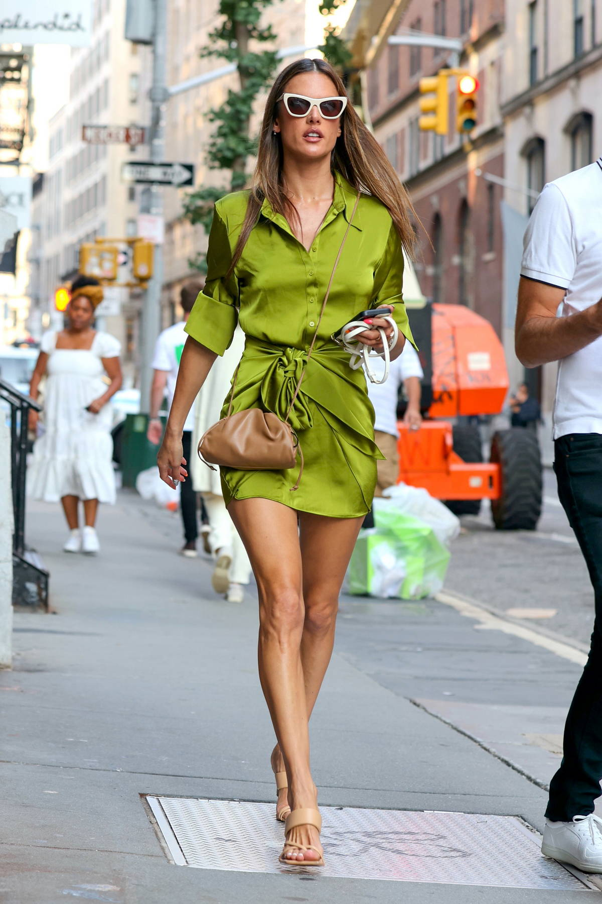 Alessandra Ambrosio looks incredible in a green mini dress while stepping out in Soho, New York City