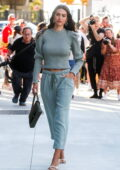 Amelia Hamlin looks cool in a sage green ensemble during New York Fashion Week in New York City