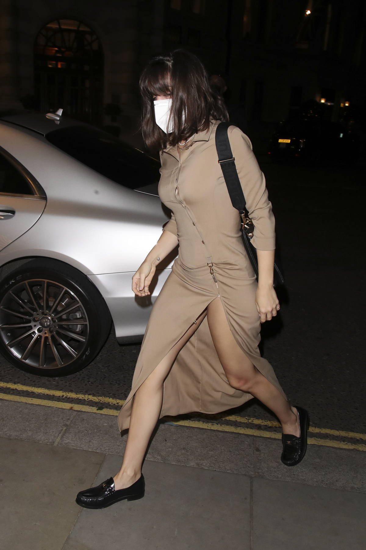 Ana de Armas looks great in a slit khaki brown dress as she arrives at The Ivy in London, UK