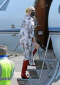 Anya Taylor-Joy looks stylish in a Dior coat paired with burgundy boots while boarding a private jet from Van Nuys airport, California