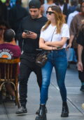 Ashley Benson wears a white tee and blue skinny jeans while out for lunch with Remington Franklin in New York City