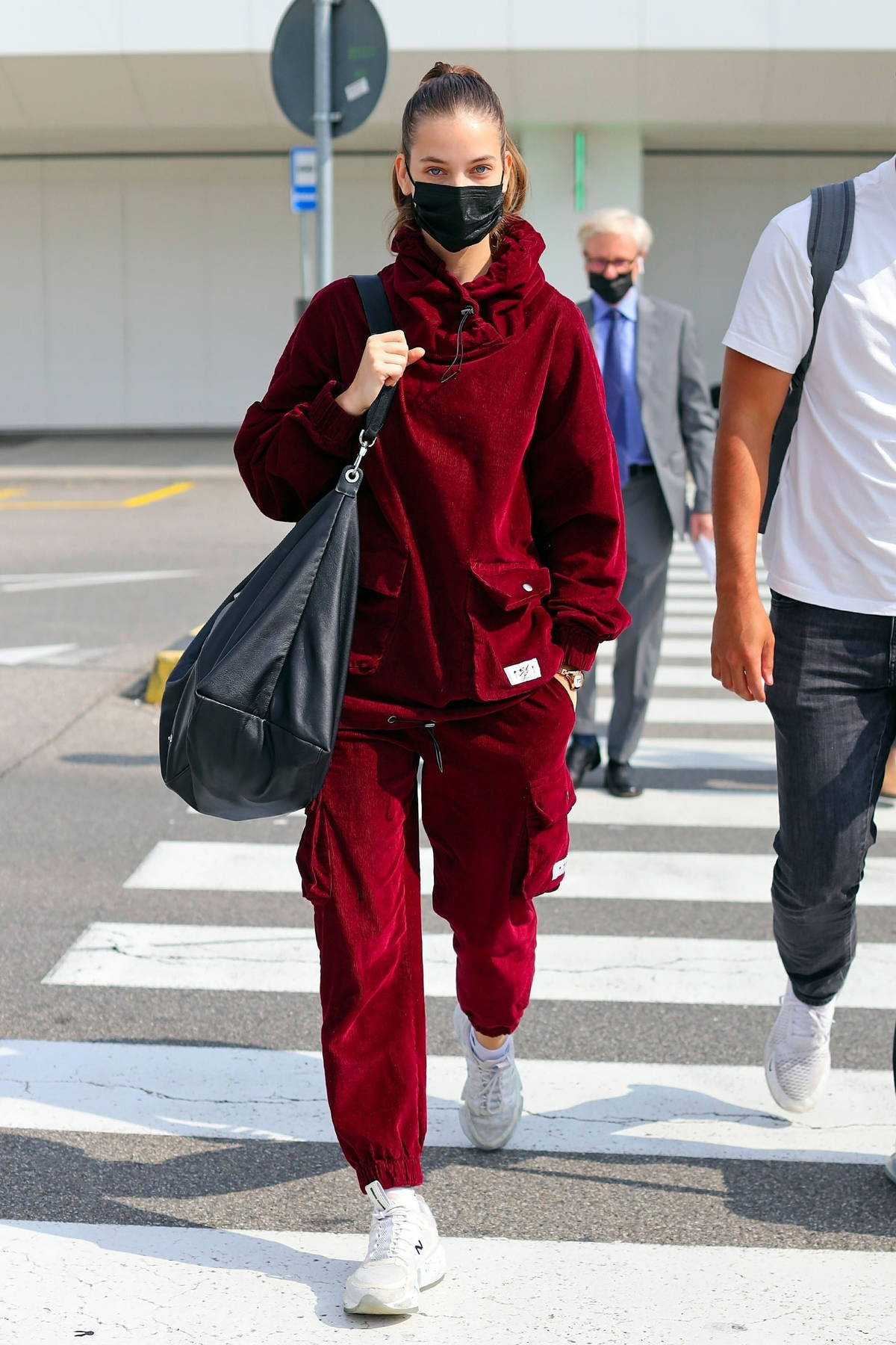 Barbara Palvin stays cozy in maroon sweatsuit while arriving in Milan, Italy
