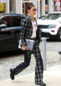 Bella Hadid looks stylish in a white top paired with a plaid suit while stepping out in New York City