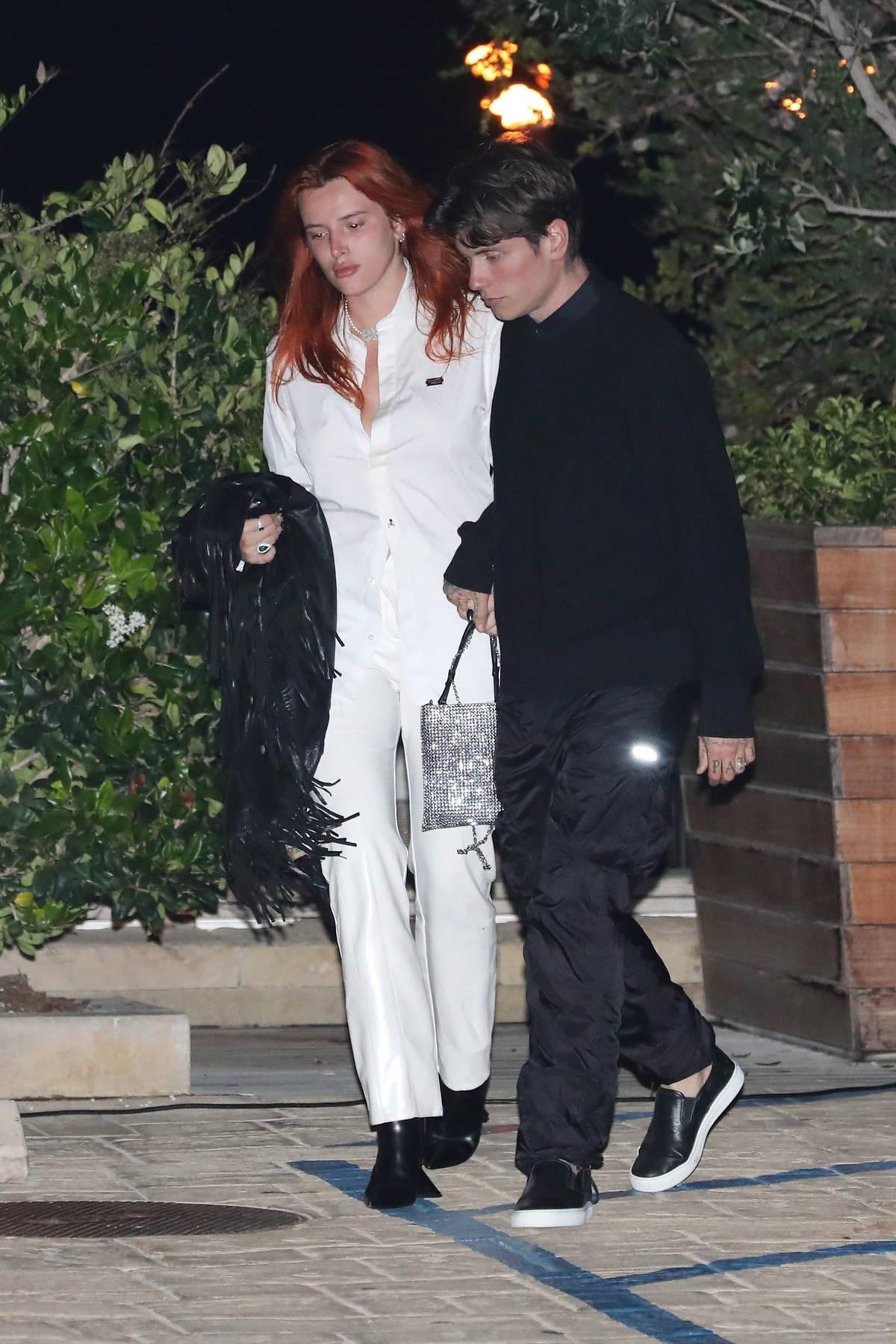 Bella Thorne and fiancé Benjamin Mascolo walk hand in hand as they leave Nobu in Malibu, California