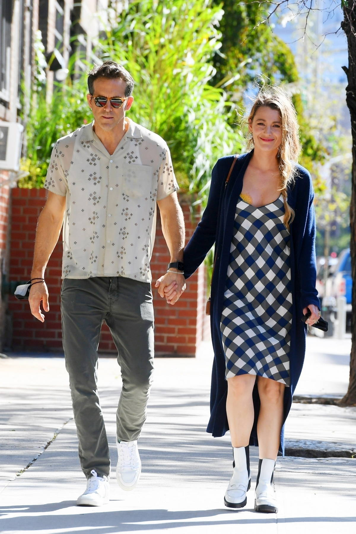 Blake Lively and Ryan Reynolds hold hands as they take a stroll through Tribeca in New York City