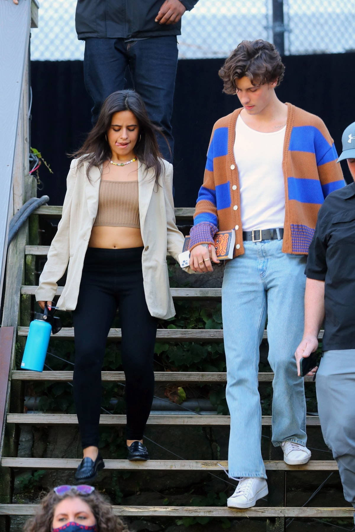 Camila Cabello and Shawn Mendes hold hands as they leave soundcheck for the Global Citizens Festival in New York City