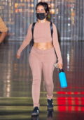 Camila Cabello flashes her midriff in a crop top and leggings as she touches down at JFK Airport in New York City