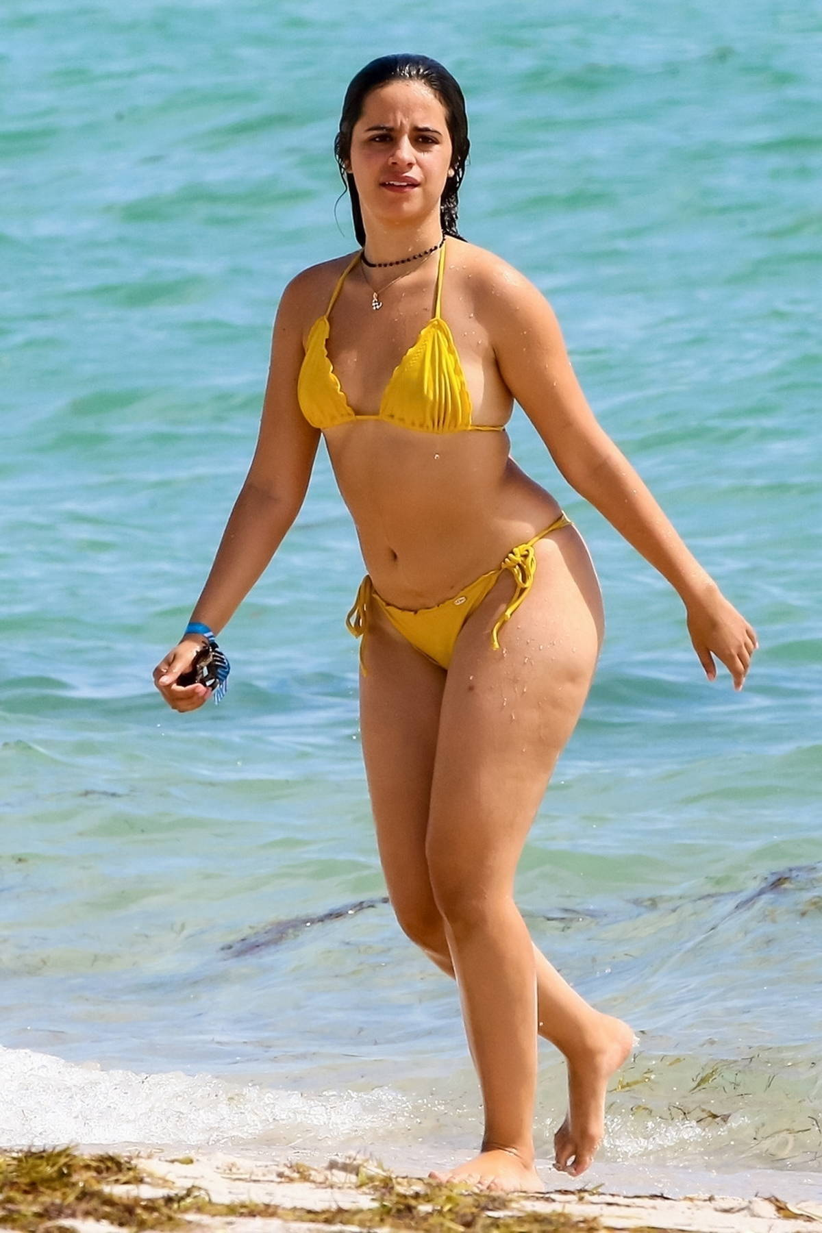 Camila Cabello flaunts her curves in a yellow bikini while enjoying a day at the beach in Miami, Florida