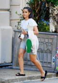 Camila Cabello wears a white tee and grey legging shorts with a Nike sneaker shape bag as steps out in New York City