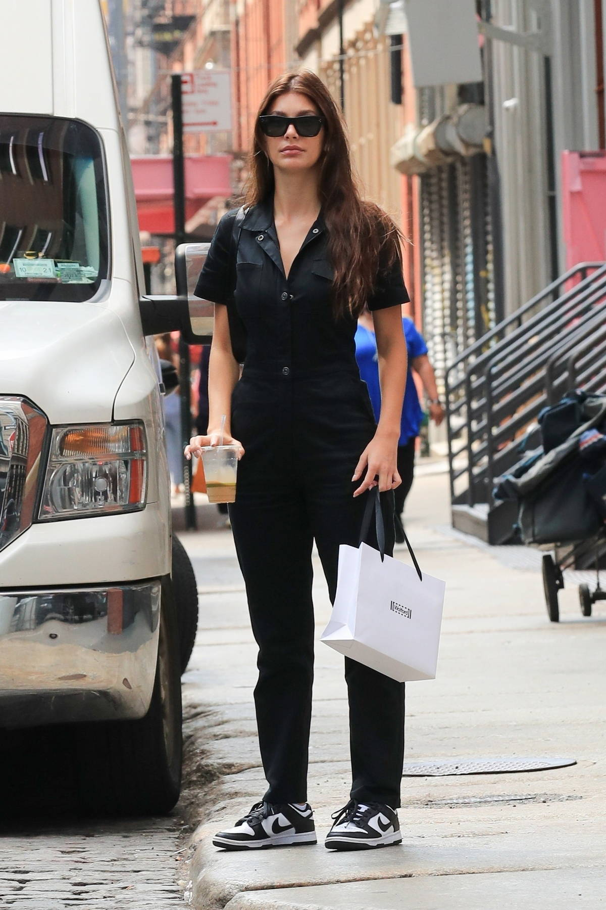 Camila Morrone and Leonardo DiCaprio step out for some coffee before shopping at a lingerie store in SoHo, New York