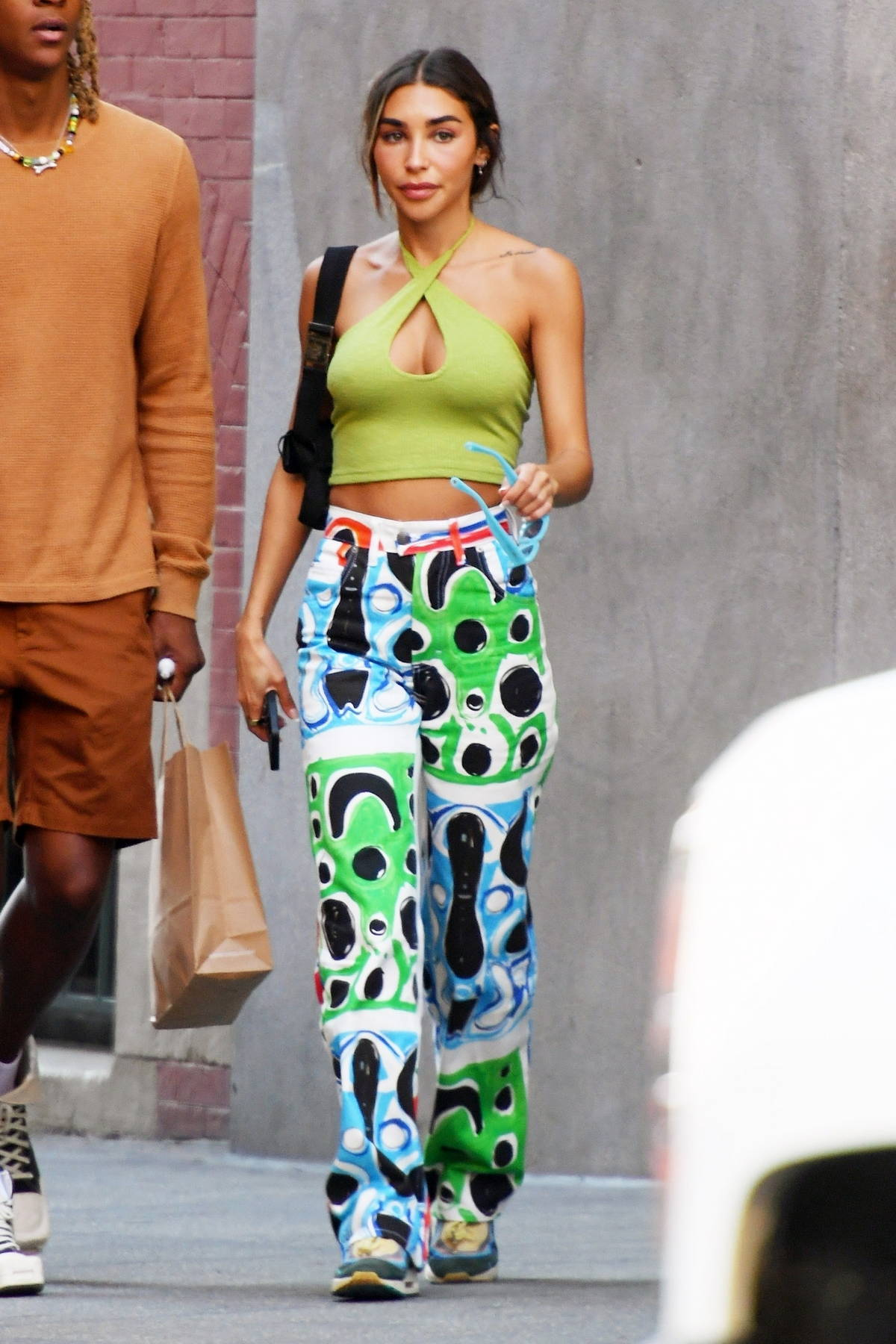 Chantel Jeffries rocks colorful pants and green crop top while out for lunch with friends at the Mercer Kitchen in New York City