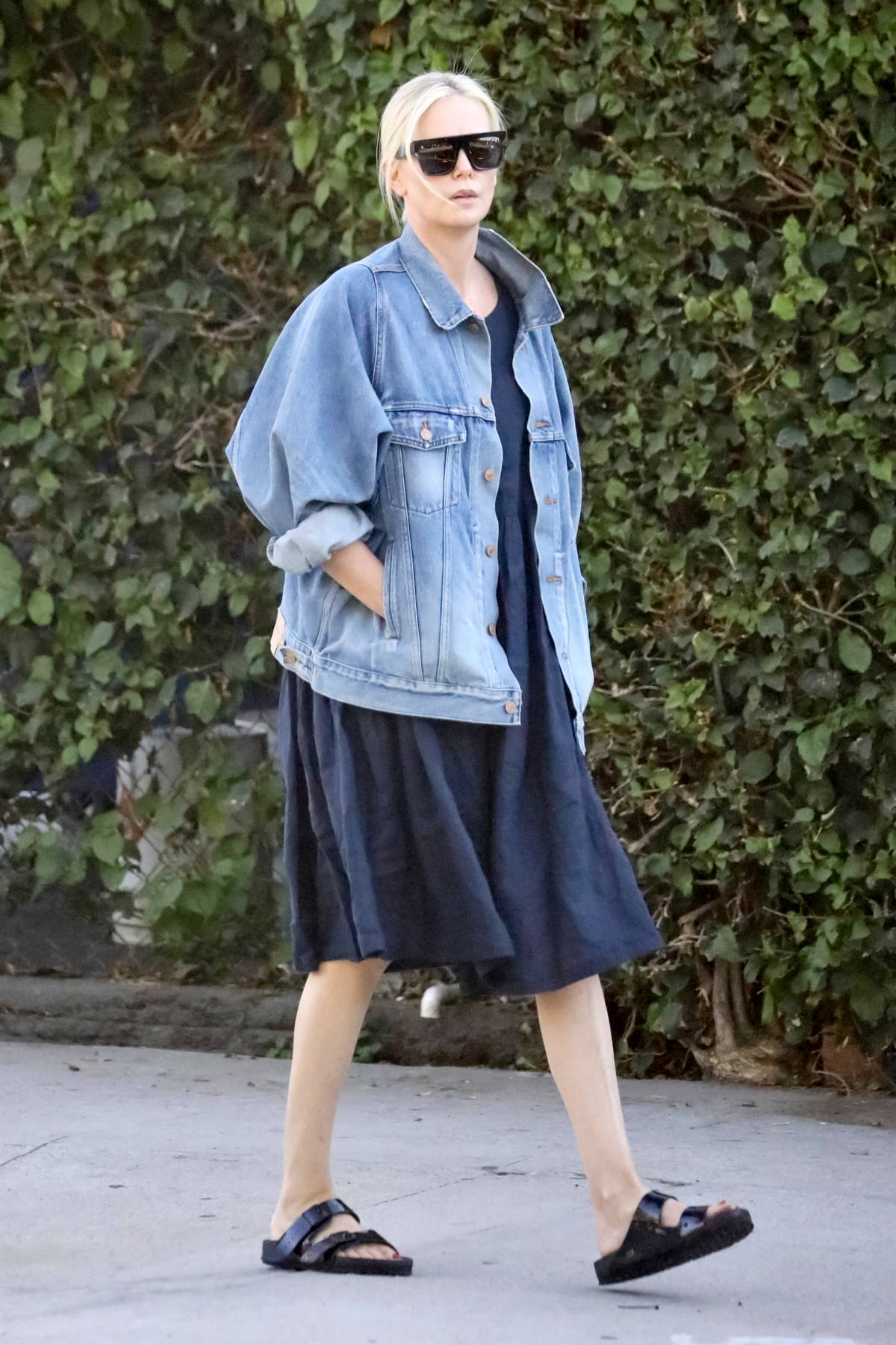 Charlize Theron returns to her car after visiting Creature Effects manufacturer in Los Angeles
