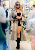 Chrissy Teigen looks chic in a grey overcoat while out for lunch with friends in New York City
