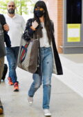 Dakota Johnson carries her personalized Gucci bag as she touches down at Marco Polo Airport in Venice, Italy