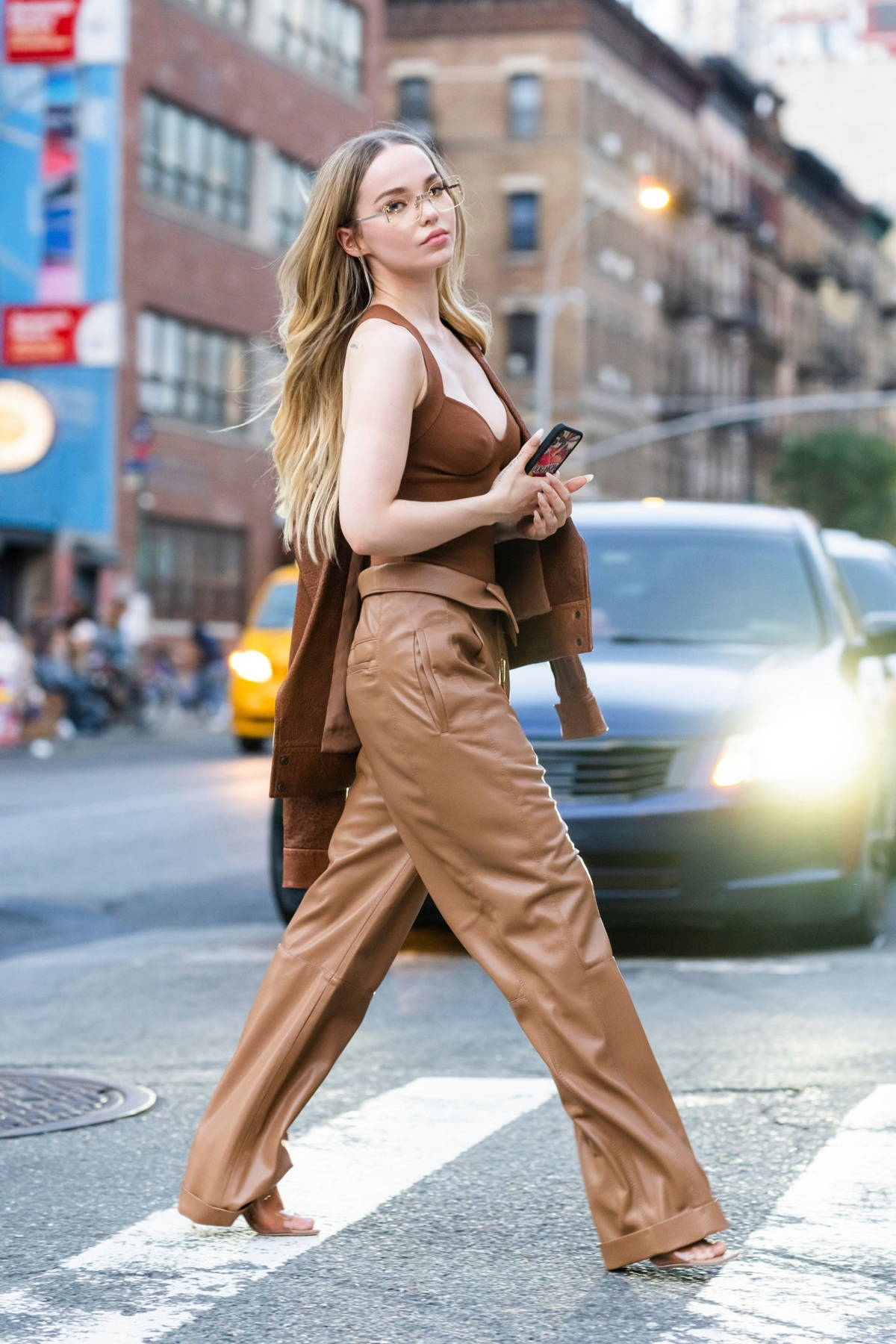 Dove Cameron puts on a stylish display in all-brown ensemble while stepping out in New York City