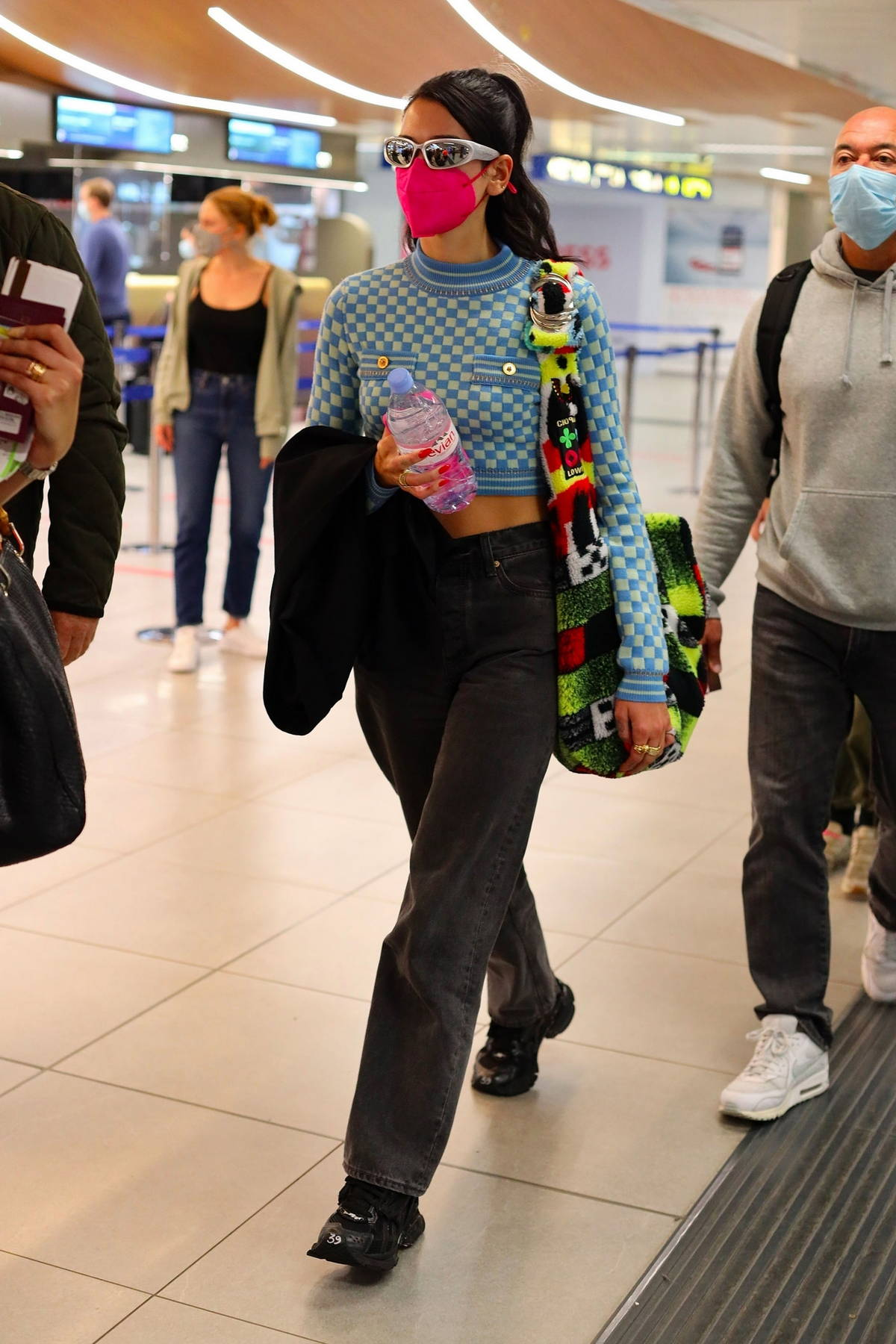 Dua Lipa looks trendy in a checkered crop top as she arrives at the airport in Milan, Italy