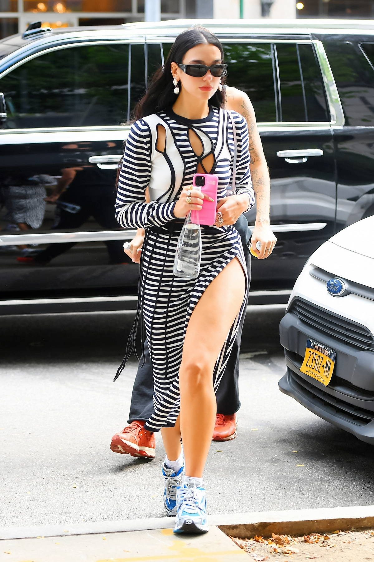 Dua Lipa looks trendy in a striped side-slit dress while heading out with boyfriend Anwar Hadid in New York City