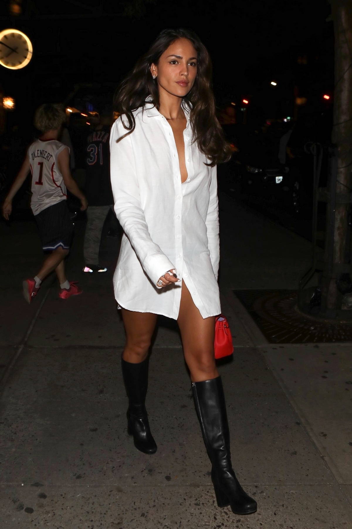 Eiza Gonzalez looks amazing in a white shirt dress while out for dinner with boyfriend Paul Rabil in New York City