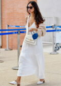 Eiza Gonzalez looks radiant in a white dress as she arrives at the Marco Polo Airport in Venice, Italy