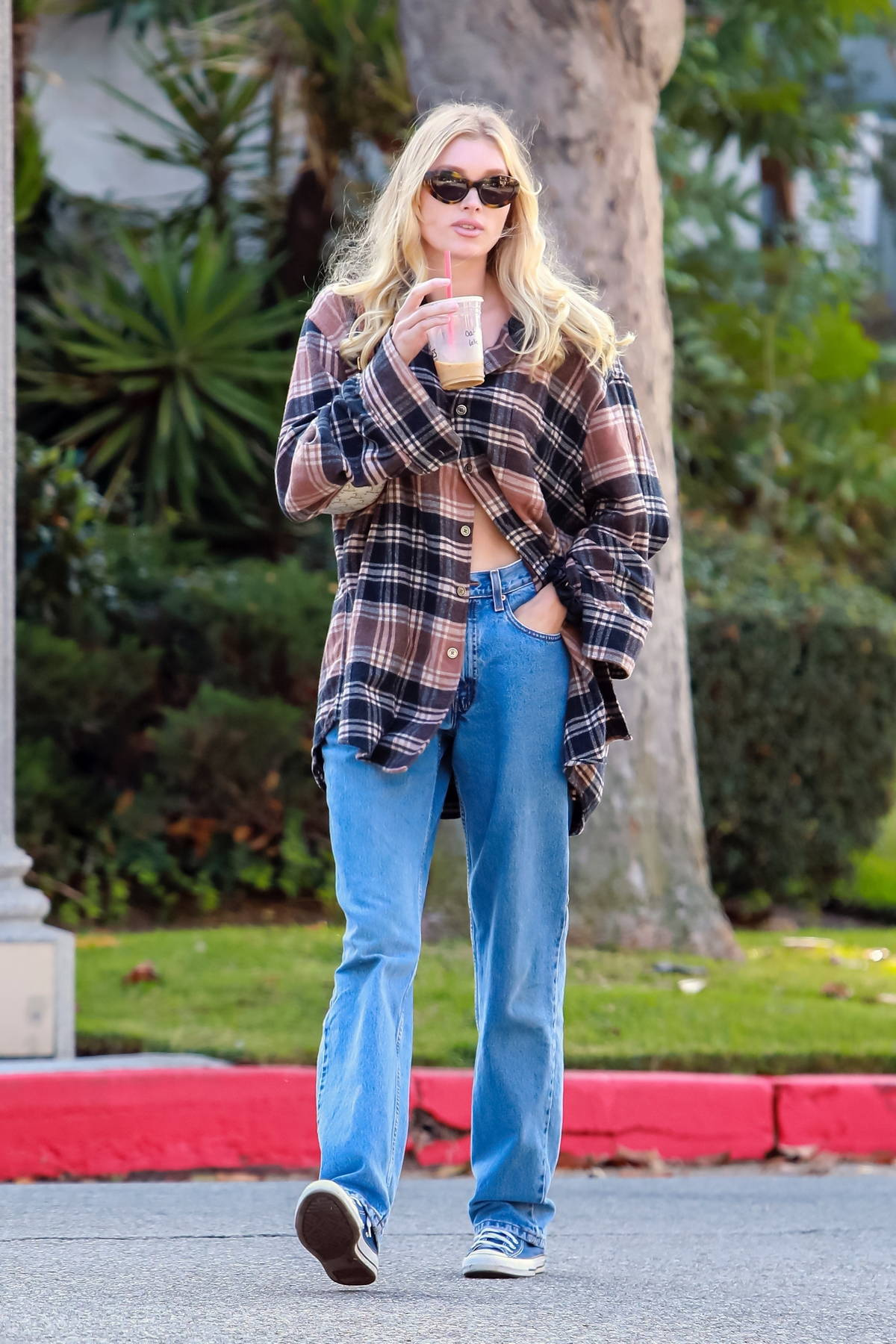 Elsa Hosk stays comfy in an oversized flannel shirt and jeans while out for a stroll in Pasadena, California