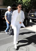 Gigi Hadid looks stylish in all-white ensemble as she steps out fittings during New York Fashion Week in New York City