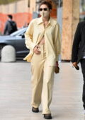 Gigi Hadid looks stylish in yellow while arriving at the Versace SS22 show during Milan Fashion Week in Milan, Italy