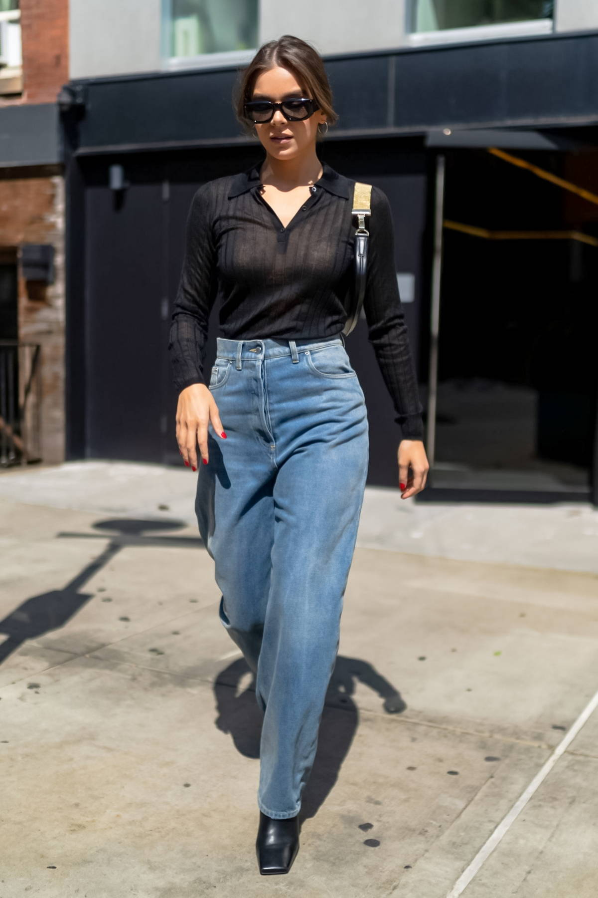 Hailee Steinfeld looks fab in a black top and jeans while out in SoHo, New York City